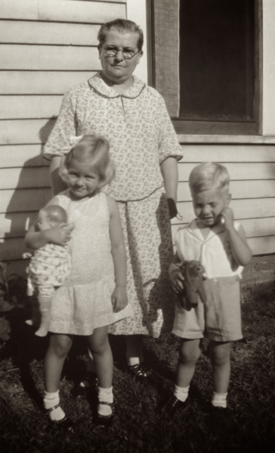 My great-grandmother with my mom and uncle.