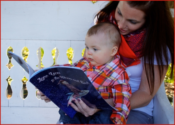 "My daughter-in-law reading ""Love you to the Moon and Back"" to my grandson"